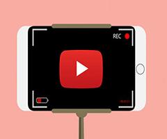 Foto de uma cãmera com logo youtube